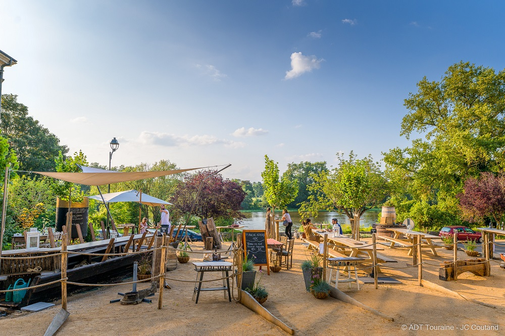 A terrace in front of the River Loire.