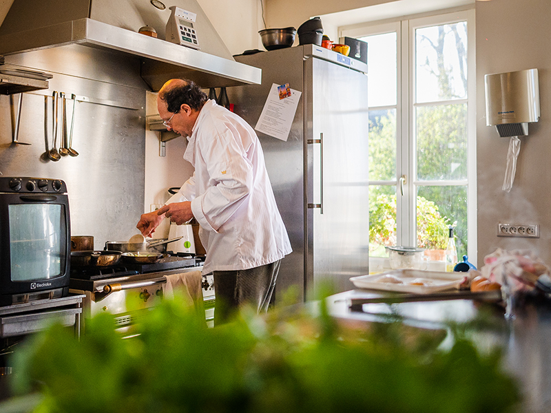 Michelin Green Star: Vincent Cuisinier de Campagne restaurant, Loire Valley, France. Vincent Simon in his kitchen, doing his best while cooking a new delicious meal insipred by french culinary. You'd better book for a lunch or for dining, as the price is not expensive.